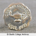 75th anniversary stickpin and 1908 Oberlin College pin