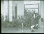 Arab villager - smoking water-pipe (American school court)